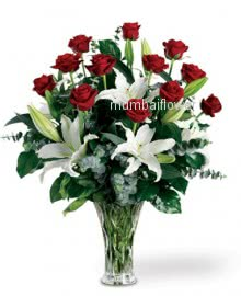 Glass Vase with Red Rose and White Lilies nicely decorated with fillers and greens