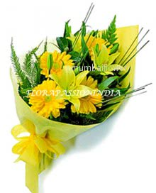 Bunch of 15 Yellow Gerberas ,2 Yellow Lilies nicely decorated with fillers and ribbons...Yellow paper packing
