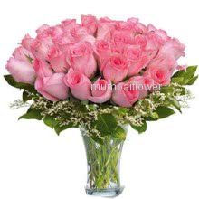 Glass Vase with 40 Pink Rose nicely decorated with fillers and greens