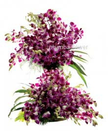 Tall Arrangement of Purple Orchids nicely decorated with fillers and grens