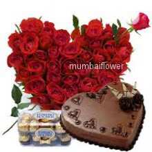 Heart shape Arrangement of 50 Red roses with 16pc Ferroro Rocher Chocolate and Half kg.Heart Shape Chocolate Truffle Cake