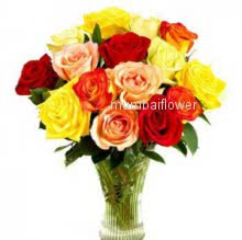 Glass vase with 20 mixed colored roses nicely decorated