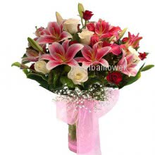 Bunch of 6 Pink lilies, 10 White roses and 10 red roses nicely decorated