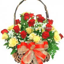 Basket of 30 yellow and Red Roses nicely decorated with fillers and greens