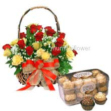 Basket of 25 Yellow and Red Roses nicely decorated with 16pc Ferroro Rocher Chocolate
