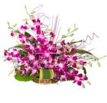 Arrangement of 15 Purple orchids nicely decorated with fillers and greens
