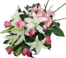 Bunch of 5 White lilies and 10 pink roses nicely decorated with fillers and ribbons