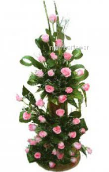 Arrangement of 60 Pink roses nicely decorated with greens