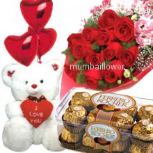 Bunch of 12 red roses nicely decorated with 16pc Ferroro Rocher Chocolate and 6 inch teddy with balloons