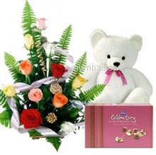 Arrangment of 15 Mixed Roses with Box of Cadbury Celebration and  6 Inches Teddy.