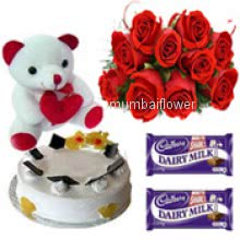 Bunch of 12 red roses nicely decorated with half kg. pineapple cake and 6 inch teddy with 2pc cadbury chocolates of Rs. 25 each