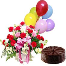 Basket of mixed flowers nicely decorated with half kg.chocolate truffle cake and simple baloons