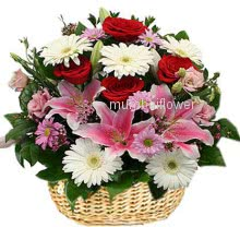 Basket of Mixed flowers nicely decorated with fillers and greens
