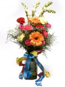 Bunch of mixed flowers nicely decorated with fillers and ribbons