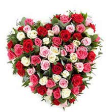 Heart shape arrangement of 50 Mixed roses nicely decorated with greens