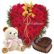 Heart shape 50 red Roses nicely decorated with 1 kg. Heart shape Chocolate truffle cake and 12 inch teddy