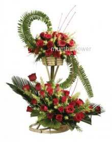 Arrangement 50 Red Roses nicely decorated with greens