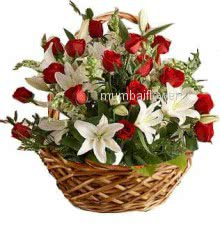 Basket of 5 pc white lilies and 20 red roses nicely decorated with greens