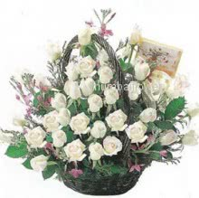 Basket of 40 White roses nicely decorated with fillers and greens