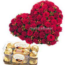 Heart shape arrangement of 100 red roses nicely decorated with 16pc Ferrero Rocher Chocolate
