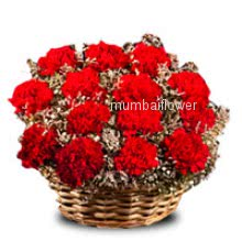 Basket of 20 red carnation nicely decorated with greens