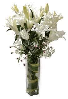 Glass vase with 5 White Lilies nicely decorated with greens... Please note : This item is not always available.