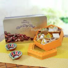 Cadbury Rich Dry Fruits with Small Box of Mixed Mithai and 2pc Decorative Diyas. Contains 250gms of Mixed Mithai,1 Cadbury Box, and 2pc Decorative Diyas