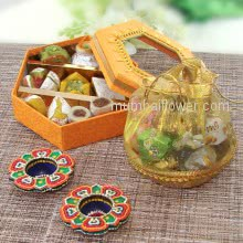 Diwali Hampers of 2pc Decorative Diya, Small Mithai Box and Basket Potli of Chocolates. Contains 200gms Mixed Mithai, 8pc Chocolates and 2pc Decorative Diyas