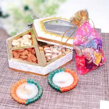 Designer Box of Mixed Dryfruits , Mixed Chocolates Potli and 2pc ready to light wax Diya. Contains 250gms of Mixed Dry Fruits,8pc Chocolates and 2pc Decorative Diyas