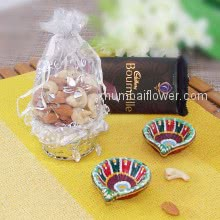 Diwali Gifts with Potli of Dryfruits with 1pc Bourville chocolate and 2pc Decorative diya. This Combo Contains 100gms of Mixed Dry Fruits, 1pc Bournville Chocolates, 2pc Decorative Diya