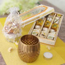 Golden Tlight Hamper with Half Kg Mixed Mithai and Potli of  Mixed Dryfruits with 1pc Golden Tealight Holder. This Combo Contains 100gms of Mixed Dry Fruits, Half Kg. Mixed Mithai and 1pc Metal Tealight Holder