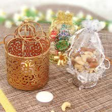 Designer Diwali Hamper of Decorative Golden Tealight Holder with Mixed Chocolates with Mixed Dryfruits Potli. This Combo Contains 100gms of Mixed Dry Fruits,  8pc Small Chocolates and 1pc Designer Golden Tealight Holder