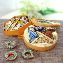 Best Diwali Hamper Combination of Half Kg. Mixed Mithai, Dryfruits and minis bounty and snicker with 3pc Decorative Diya. This Combo Contains 400gms of mixed Mithai, 100gms of Mixed Dryfruits, 12pc Small Chocolates and 3pc Decorative Diyas
