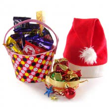 Christmas Bucket filled with Premium Chocolates , 1 Red Santaclaus Cap  and 12pc Christmas Tree Decorative Ornaments