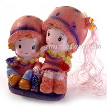 Cute Gift Couple Showpiece with girl holding heart and boy holding flowers, so cute. Delivered with Personalised Message Card. <br><br> Size: 20cm x 18cm x 09cm approximately.