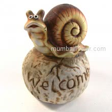 Showpiece of Snail with Welcome also can be used as baby money bank.  <br><br> Size: 16cm x 11cm x 11cm