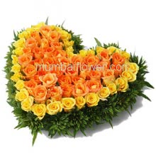 100 Yellow and Orange Roses Heart Shape Arrangement with fillers and greens