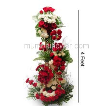 Tall Arrangement of 150 Red Roses and  Carnation with fillers and greens.<b>Please Note : </b> Photo is for Idea only actual shipment may vary in design decoration.