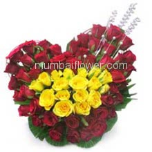 Heart Shape Arrangement of 50 Red and Yellow Roses with fillers and greens