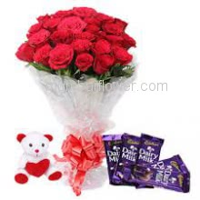 Bunch of 20 Red Roses with Plastic Cellophane packing and 5 pc Cadbury Dairy Milk with 6 Inch Teddy