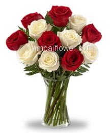 Glass Vase with 15 Mixed Red and White Roses with filers and greens