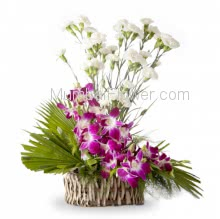 Arrangement of 20 White Carnation and 6 PC Purple Orchids nicely decorated with greens. <b>Please note:</b> we may substitute color in case of unavailability