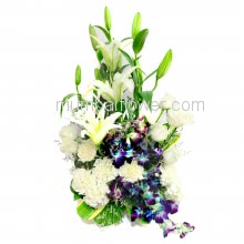 Arrangement of 10 White carnation, 10 white Roses, 3 PC White Lilies and 6 PC  Orchids with fillers and greens. <b>Please note:</b> we may substitute color in case of unavailability