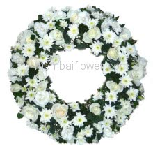 With heartfelt condolences.With deepest sympathy. Wreath Sympathy Flowers.20 White gerberas and 30 white roses