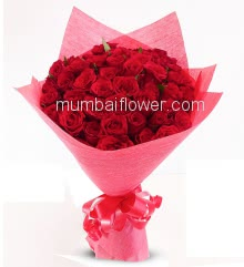 Stunning Bunch of 75 Red Roses nicely decorated with fillers and ribbons, packed with exclusive Red Paper Packing