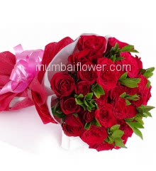Hand Bouquet of 25 Red Roses nicely decorated with colored Paper Packing and Ribbons