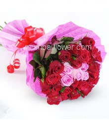 Romantic and lovely Hand Bunch of 30 mix Red and Pink Roses nicely decorated with colored Paper Packing and Ribbons