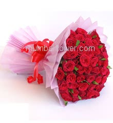 Bunch of 45 Red Roses nicely decorated with colored Paper Packing and Ribbons. Purely a heart winner.