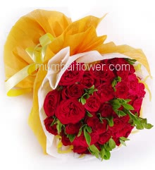 Pretty Hand Bunch of 35 Red Roses nicely decorated with colored paper packing and ribbons