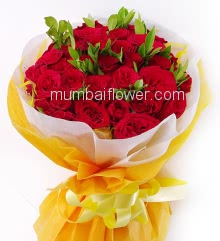 Stunning Hand Bouquet of 35 Red Roses nicely decorated with fillers and ribbons, packed with exclusive paper packing